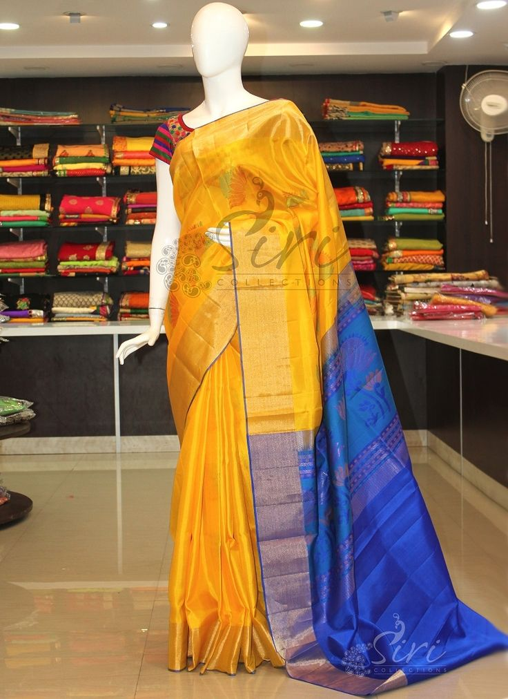 Pure uppada silk saree in yellow and royal blue with rich pallu and flower butis.   It comes with an unstitched blue blouse fabric same as the pallu's colour....