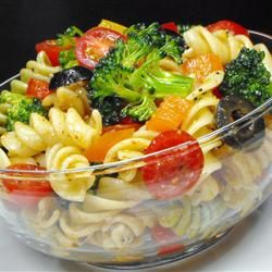 Chocked full of Veggie Pasta Salad: whole wheat pasta with broccoli, peas, cucumber, cauliflower, carrots, black olives, cherry tomatoes, orange peppers, Parmesan and either Caesar or Italian dressing