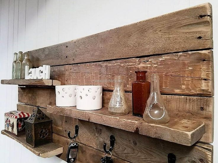 The repurposed wood pallet shelf and key rack combo can be seen with the different decorative items placed on it, placing same items on one shelf is also a good idea. This idea can be copied for the kitchen as well if there are many spice bottles and the space to place them is less.