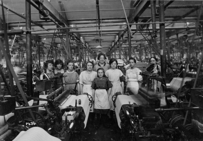 Weavers at their looms in the cotton mill - During the 1890s and early 1900s the mills were very noisy and dangerous places to work due to the machinery. The workers developed a system of sign language to communicate with each other over the din of the machinery. Many people became ill with respiratory and lung conditions caused by breathing in the cotton dust. The majority of employees were women and children who worked around 12 to 14 hours a day