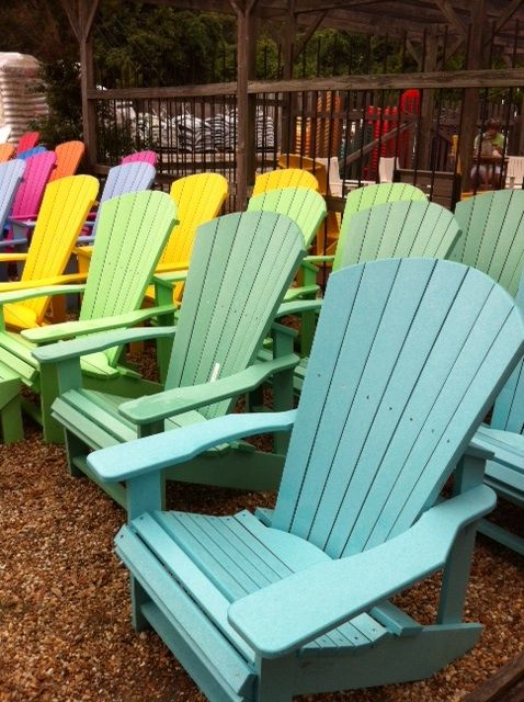 A Rainbow Of Recycled Plastic Adirondack Chairs.