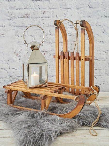 Our old-fashioned decorative wooden sledge is a blast from the past - perfect for recreating the style of a cosy ski lodge anywhere in your home.
