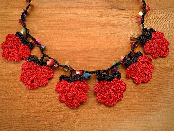 This necklace is completely crocheted with black and pinkish red polyester thread, multicolored beads and a very fine hook. In reality the red is a bit more pinkish than the red in the picture. Length: 52 cm / 20½ in Our other necklaces are here: http://www.etsy.com/shop/PashaBodrum?section_id=6884137 Dont forget to check out the rest of our shop: http://www.etsy.com/shop/PashaBodrum