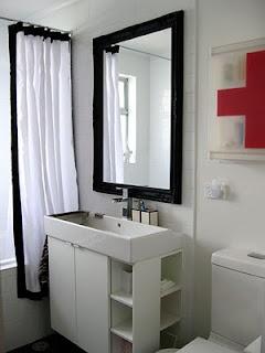 Bathroom with painted ornate mirror and Ikea vanity