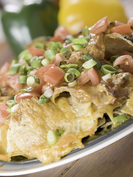This delicious beef nachos with cheese recipe is one of many nachos recipes you can make. This recipe is perhaps more gourmet than some nachos with cheese recipes because you use beef sirloin rather than ground beef. This gives a different look, flavor, and appearance and makes this appetizer stand out.