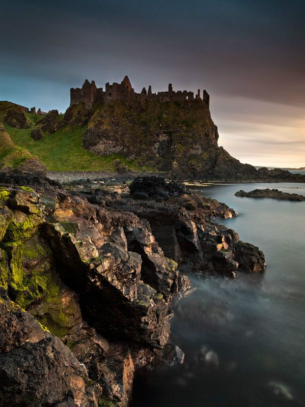 Dunluce Castle ruins once stood on the dramatic coastal cliffs of north Antrim, Ireland.