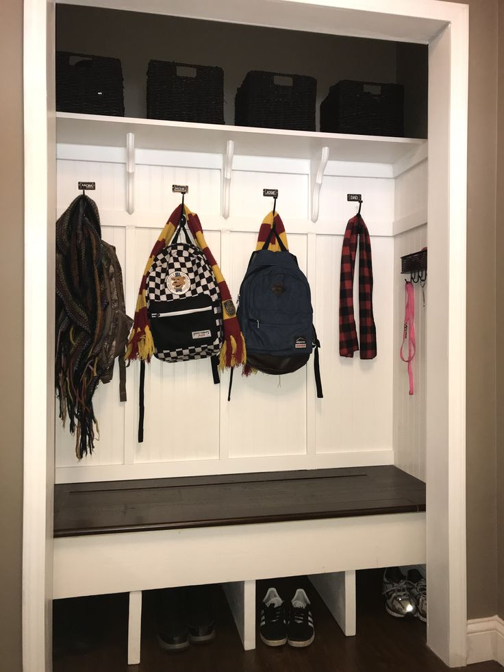 converted the closet by my front door into a mudroom bench with personal coat hooks shoe cubbies and baskets for each member of the family