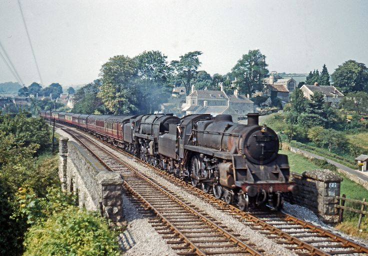 Standard 4 4-6-0 75027 and 9F 2-10-0 92001 pass Wellow with the So Bournemouth - Derby service, 2/9/61.