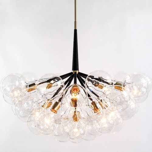 The Supra Chandelier is the newest addition to the Pelle's Bubble Collection. Composed of 11 clear globe lamps nested in a cluster of matching clear glass spheres, this fixture is breathtaking when illuminated.