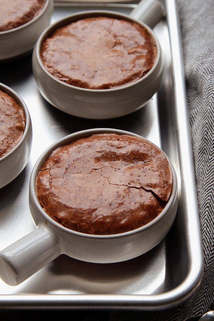 NYT Cooking: I can make no dietary defense for the choco-hoto-pots: they're just good. Think ponds of molten chocolate sauce enclosed in chewy-topped, dense chocolate sponge. By popular request, I paint the lily here by adding a sprinkle of white chocolate morsels.