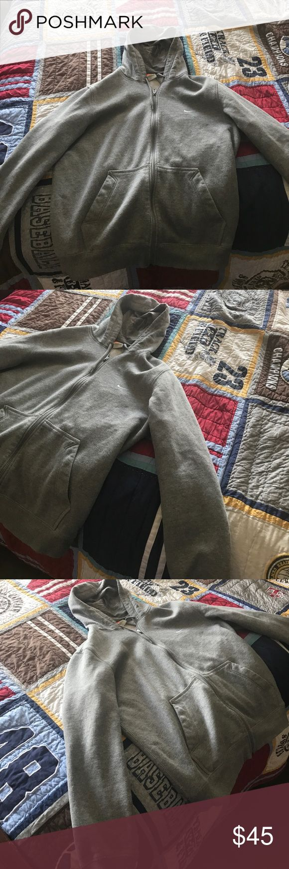 grey nike jacket it is a size extra large. it is not new Nike Jackets & Coats Performance Jackets