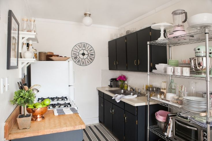 { black cabinets + gold hardware } Alaina Kaczmarski's Lincoln Park Apartment Tour #theeverygirl