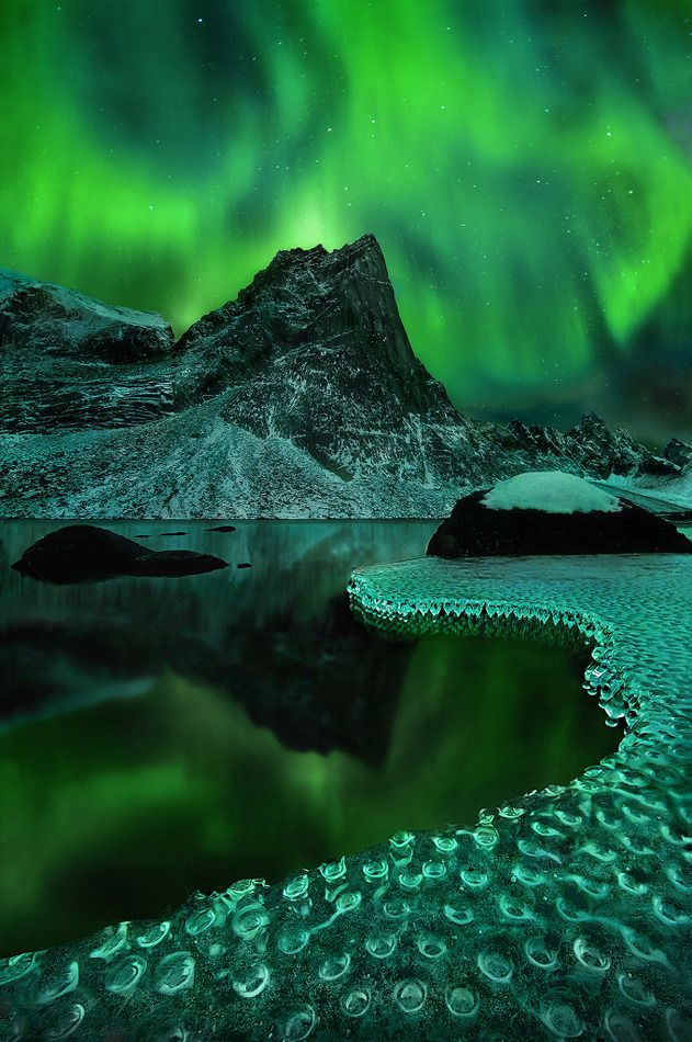 Aurora Borealis reflected on frozen icicles (Northern Yukon Territory, Canada)