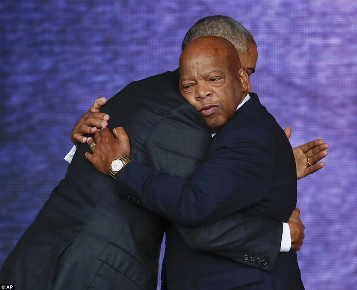 Obama embraces Lewis, who helped usher in legislation through Congress for the museum, before his speech