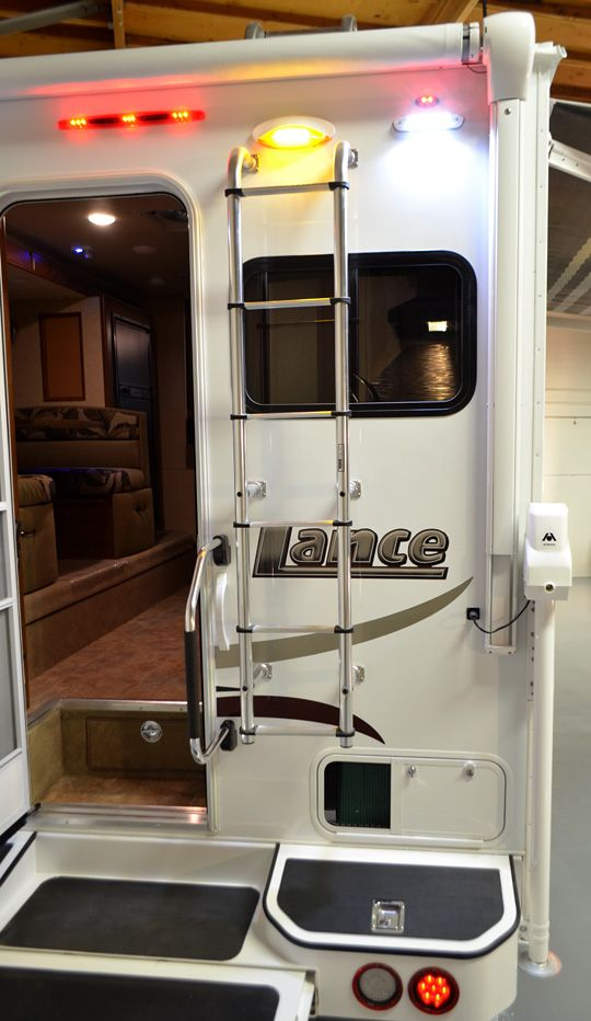thinking of getting a smaller fold up ladder and keep up under instead of having this one cover part of the window..and I am loving the storage bins in the back of the camper as well!