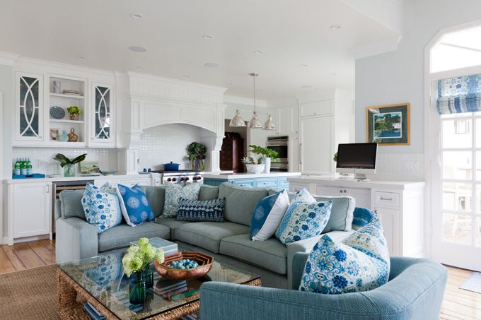blue and white open-concept family room   LLH Interiors