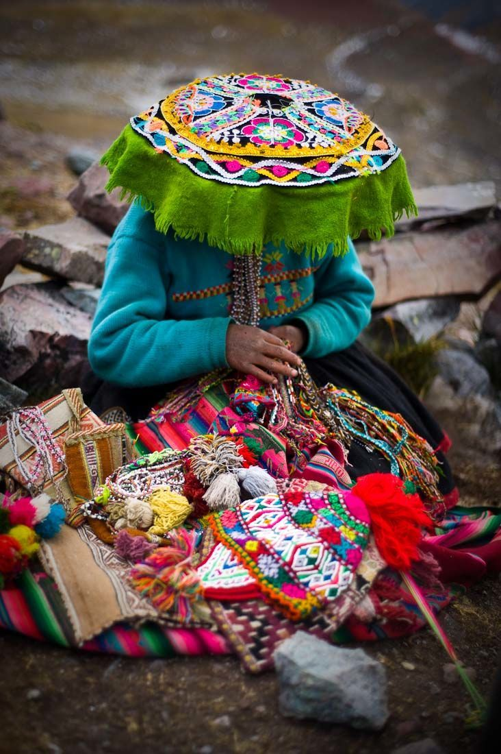 A young girl making textile along the trekking route around Mount Ausangate, Peru, by Joshua Lawton