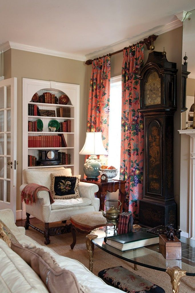 .The drapes and the old grandfather clock save it from too much white.