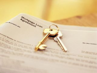 My First Home picture idea. Keys with morgage agreement papers.