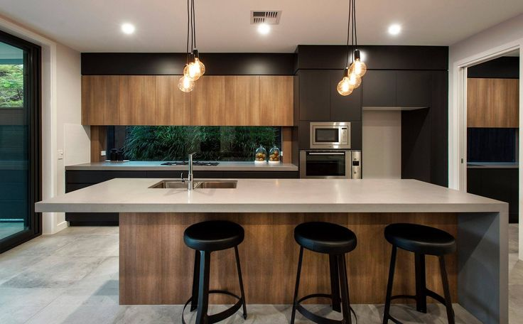 This modern home has an incredible and sophisticated look with Caesarstone concrete countertops  used in the kitchen, the bathroom, and the laundry. Beautiful, practical and sustainable.