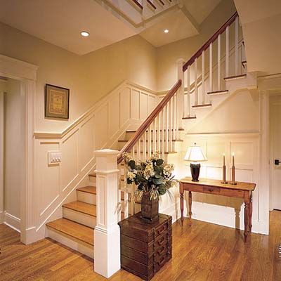 Wainscot:Creates a more formal appearance. This stair case has a heighten look of class because of the wainscot boarder.