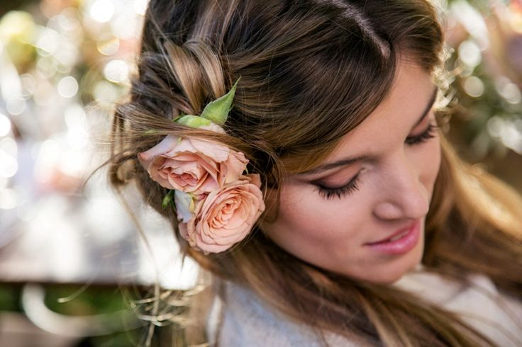 half hair styled down with soft rolls to the side, accessorised with small antique rose buds, capturing the deco style of the 1930s, yet retaining a modern twist. #frankgiacone