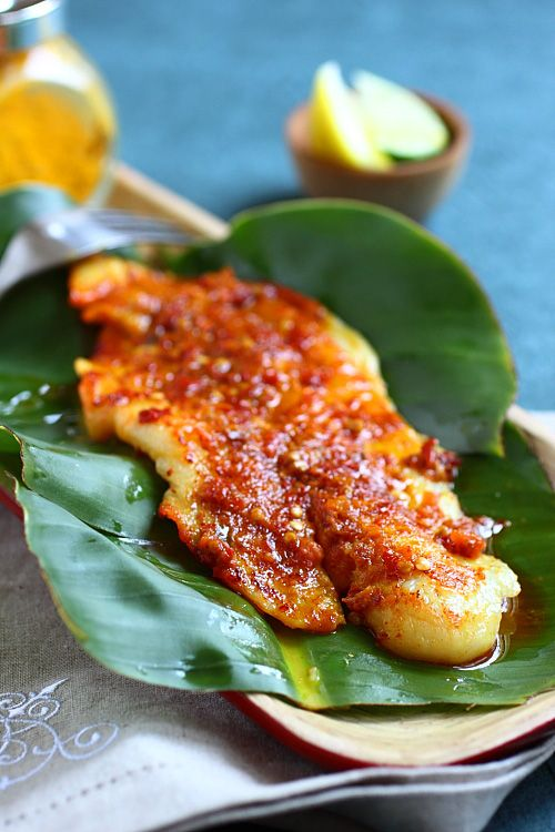Ikan Panggang/Ikan Bakar (Grilled Fish with Banana Leaves) recipe - The smell of burnt banana leaves imparts the fish with a smoky flavor and the sambal infuses the fish fillet with layers upon layers of spicy taste. #malaysian #fish
