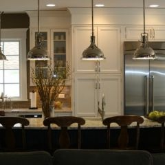 White cabinets with large crown to ceiling in this traditional kitchen by The Kitchen Studio of Glen Ellyn
