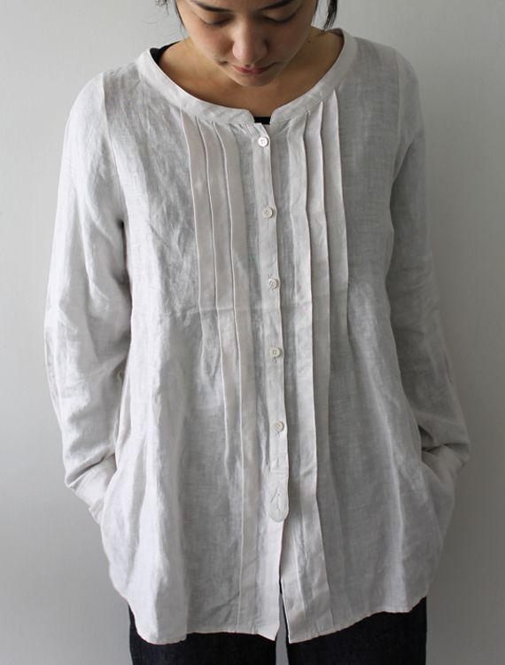 Take a Man's old Shirt and remake it into a top for yourself. (I with I had done this to my Dad's old shirts):