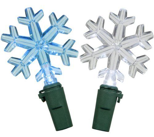 """Set of 50 Blue and Clear LED Snowflake Christmas Lights - Green Wire by VCO. $24.99. Set of 50 Snowflake Christmas Lights Item #X6G5015   Features:   Color: clear bulbs with blue & clear snowflake light covers / green wire   Number of bulbs on string: 50  Bulb size: rice light Light type: LED  Spacing between each light: 6""""   Lighted string length: 25 (7.62m)   Total string length: 26 feet (7.92m)   Wire Gauge: 22 Dimensions of each snowflake: 1.5""""W x 1.25""""H Additional Produc..."""