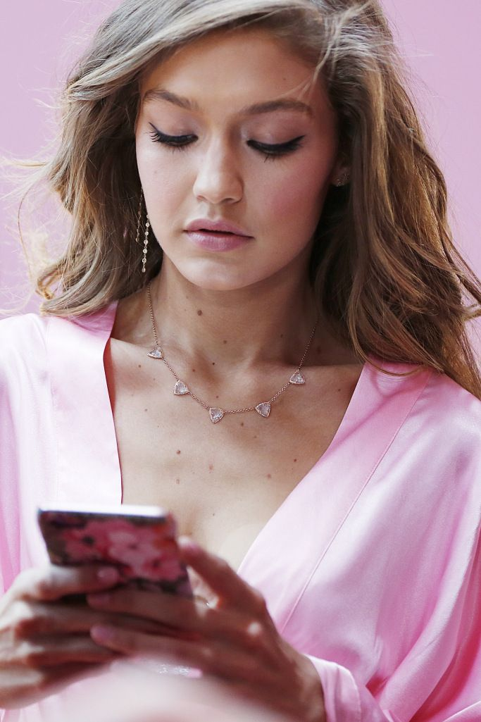 Victoria's Secret Fashion Show 2016: Gigi Hadid checks her phone after hair and makeup.