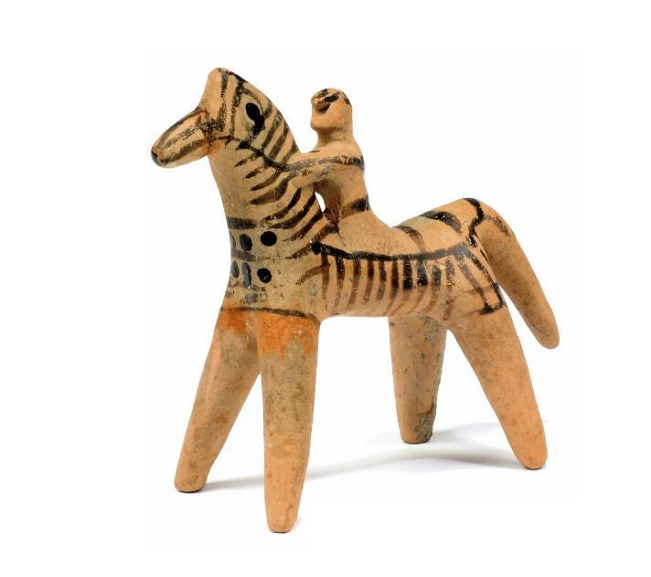 Boeotian horse and rider, mid 6th century B.C. Decorated with dark brown lines and dots, the rider clutching the horse's neck, 10.5 cm high. Private collection