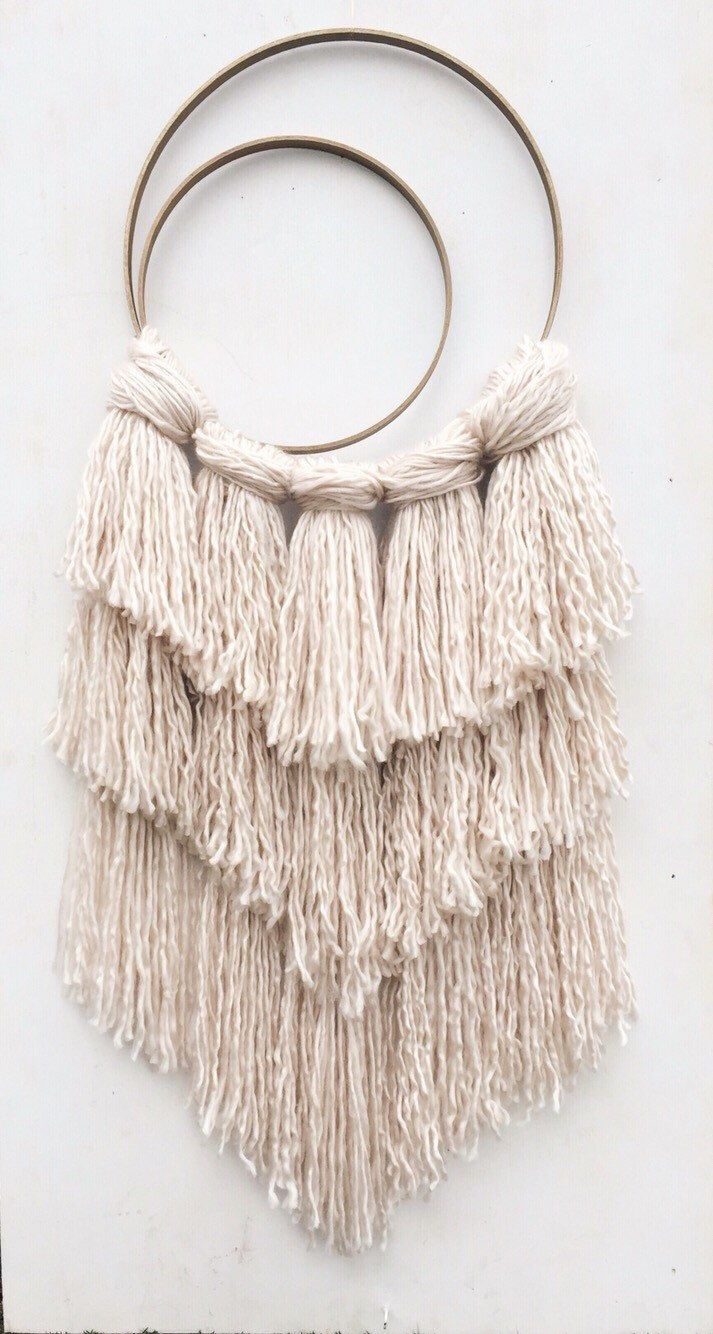 A personal favorite from my Etsy shop https://www.etsy.com/listing/272339726/desert-rose-dreamcatcher-shaggy-yarn