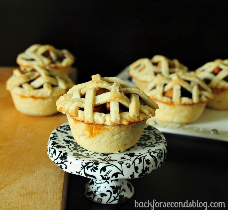 Individual Apple Pies - Easy yummy homemade crust overfilled with caramel-y cinnamon apples! Delicious!! http://backforsecondsblog.com  #applepie #easypiecrust #thanksgiving