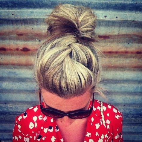 criss-cross hair pulled back into bun.