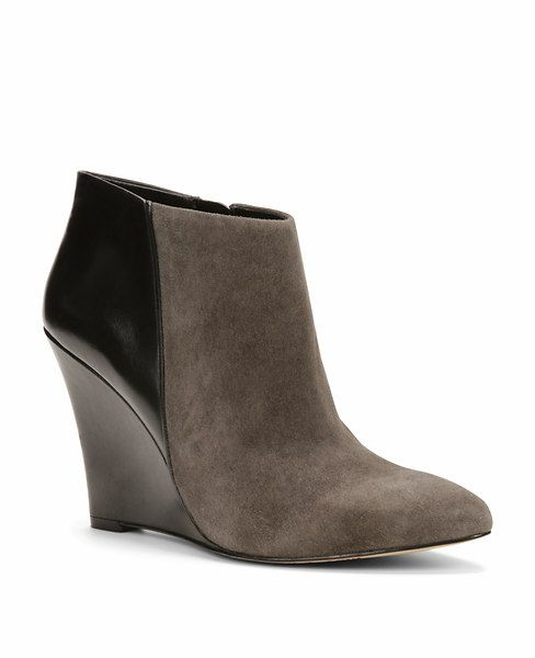 Nothing more essential for fall than a perfect pair of wedge boots, especially in a sleek combo of leather and suede.