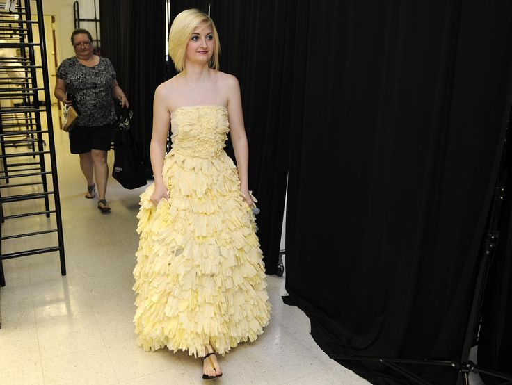 Caitlyn Gerwitz, a student at Westminster High School, will be modeling this dress in a wearable art fashion show at Savage Mill on Sunday. The dress is made from rubber gloves. Her mother, Amy Gerwitz, is behind her.