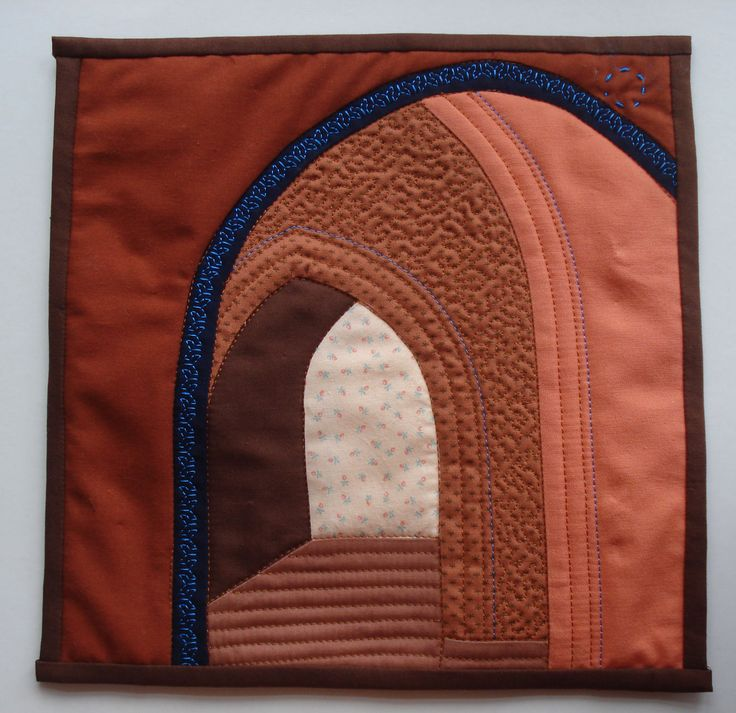 May: Marrakech archways, typical colouring of the city, seen in the old town. Shapes pieced together and then quilted. Made by Greta Fitchett.