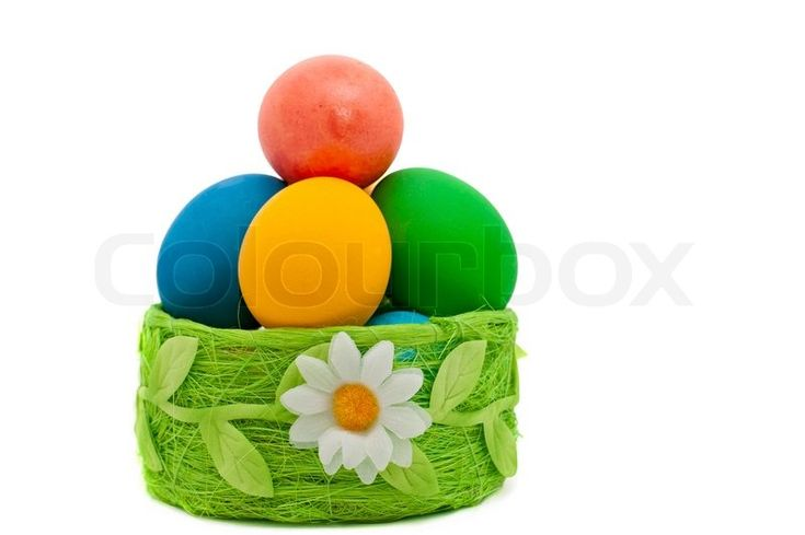 Easter eggs in the green basket over white | Stock Photo | Colourbox on Colourbox