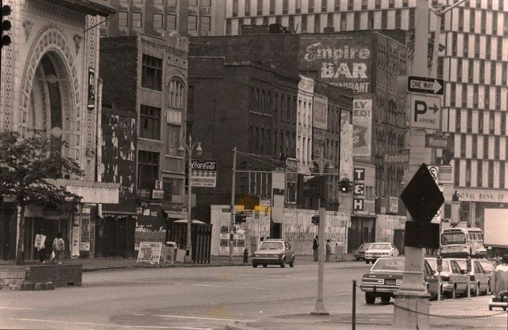 On this date 27 years ago, the #Detroit City Council voted to raze 12 of the 13 Monroe Block buildings. The site has been a parking lot ever since.  Photo from the Detroit Free Press archives — in Detroit, Michigan.