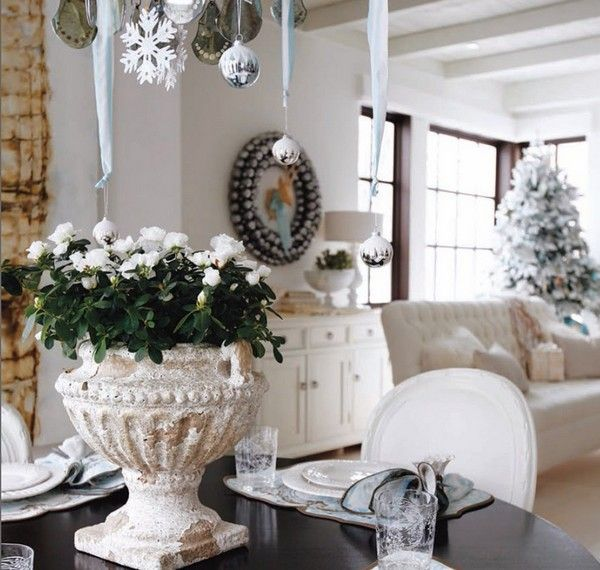 wonderful christmas home decor idea with black table with white chair white flowers in the white pot and silver hanging christmas balls