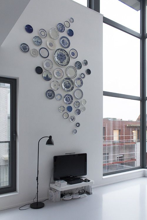 love the plate collage, but the tv stand and lamp are so sadd.... kinda ruins it?