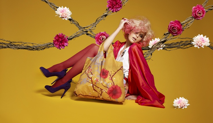 Bold reds burst out of toasty oranges. Omnisax bags make a statement.