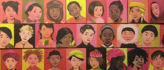 Une fois le livré déplié s'alignent les visages souriants des enfants du monde entier.