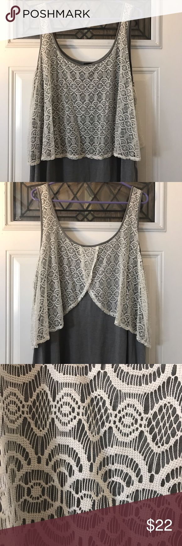 Lace Tang Top Gray Tang Top with Lace over lay. Size 2 at Torrid. Hits at Hips. Lightly warn. No snags on lace. Great condition. Tops Tank Tops