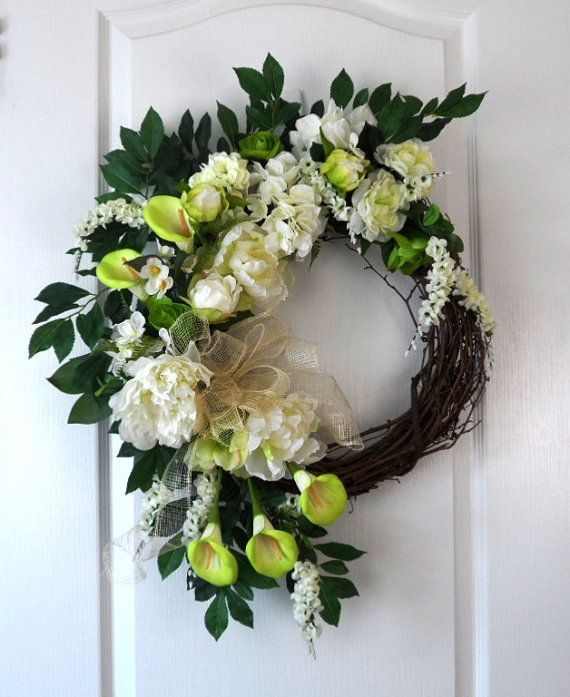 Pretty white wreath for everyday, showers, weddings.  Any event you need some decor.  Hang on your front door to celebrate Spring!