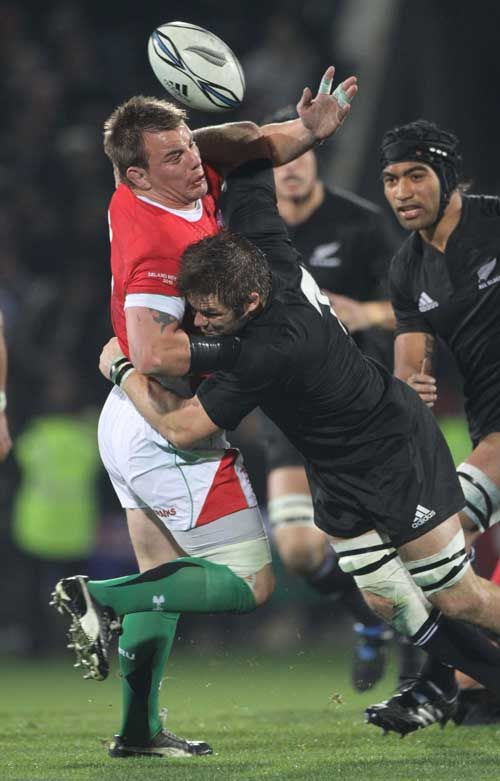 New Zealand's Richie McCaw tackles Wales' Matthew Rees