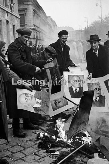 The Hungarian Revolution began with a first mass-rally in Budapest on October 23,1956.It was crushed by Soviet tanks and artillery after days of street-fighting.In front of the Budapest Communist Party Headquarters, passers-by burn pictures of Party Secretary Matyas Rakosi.