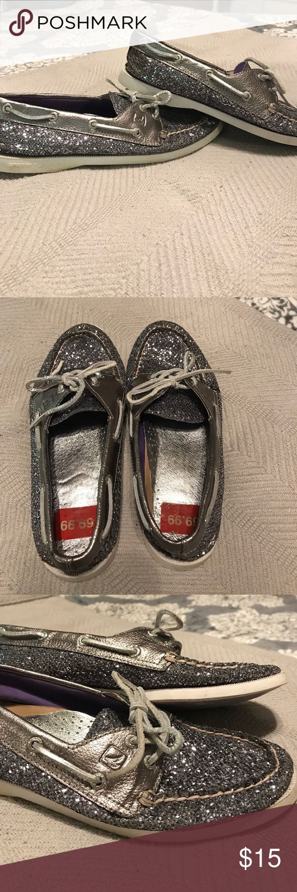 SALE!! Silver Glitter Sperry Top-Sider's Size 7 PRICE REDUCED!! Gently used silver with purple undertones size 7 Sperry Top-Sider boat shoes... These are still in great condition, a little flat from storage but only worn a couple of times! Very sparkly, glitter with silvery/gunmetaly colored leather trim and laces. White rubber sole, lavender rubber on bottom. Nice, unique shoes, fun for summer! Inside in great condition as well. Make me an offer! Sperry Top-Sider Shoes Flats & Loafers