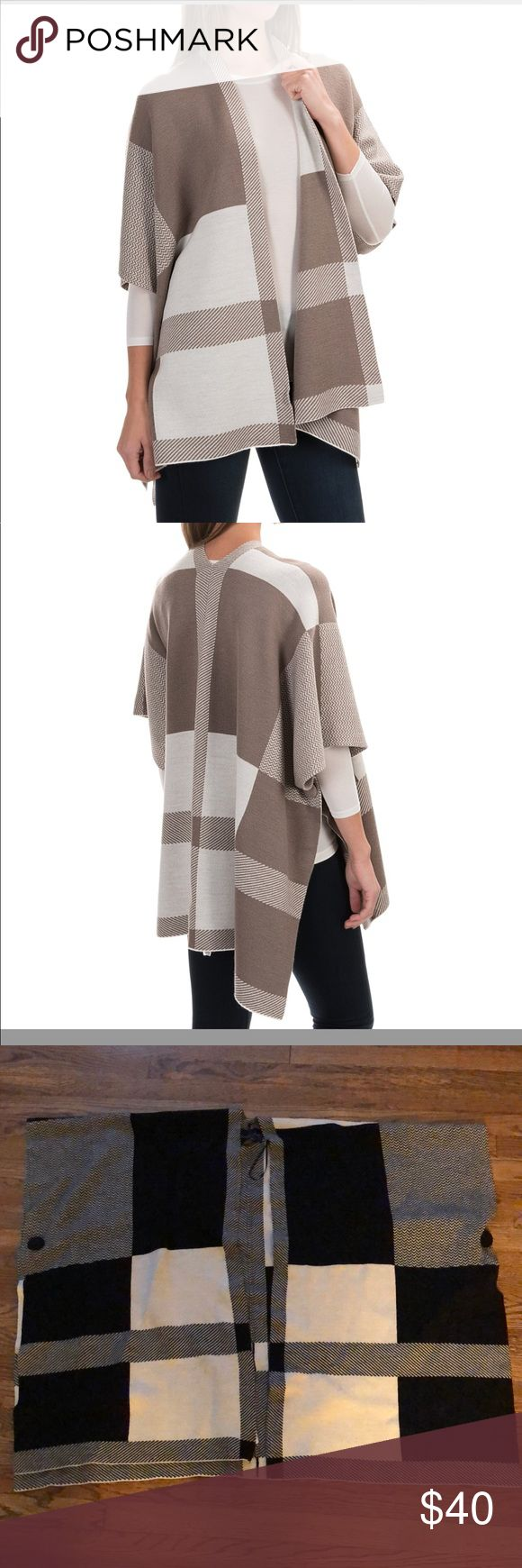 Adrienne Vittadini open front poncho sweater Adrienne Vittadini Color-Block Wool Poncho in BLACK AND WHITE! Adrienne Vittadini's Color-Block wool poncho offers a cozy way to usher in cooler weather. With decorative buttons at the side and a mix of patterns on the color-blocked wool, this toasty layer offers eye-catching appeal when worn with jeans, leggings and your favorite skirts. Please note, stock photos for fit. Color is BLACK AND WHITE   Warm wool knit Open front Buttoned side…